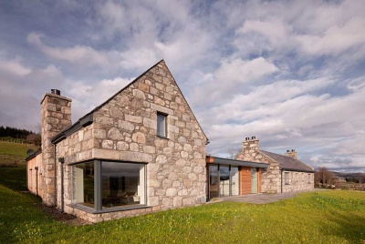 stone home in the highlands with glazed timber link