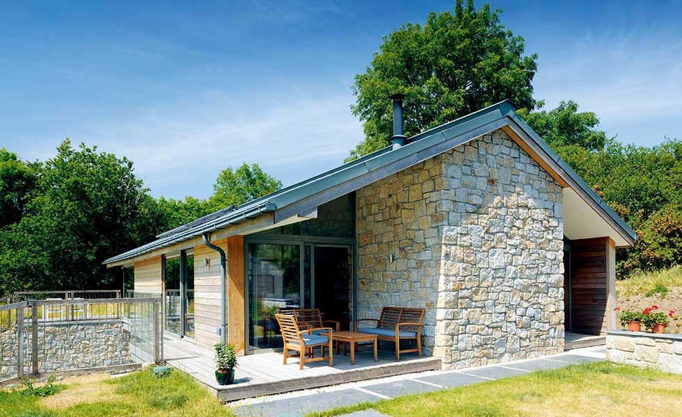 Granite clad self build with timber cladding in Dartmoor
