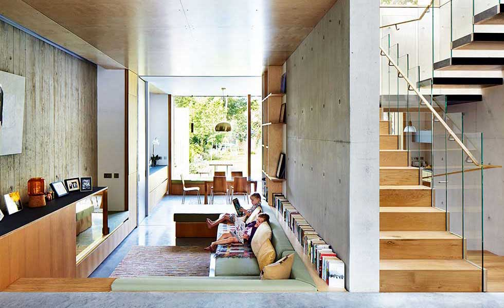 home with polished concrete floor and shuttered concrete wall cladding