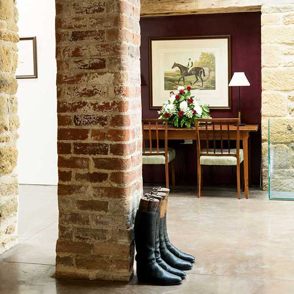 converted barn with exposed brick and polished concrete floor