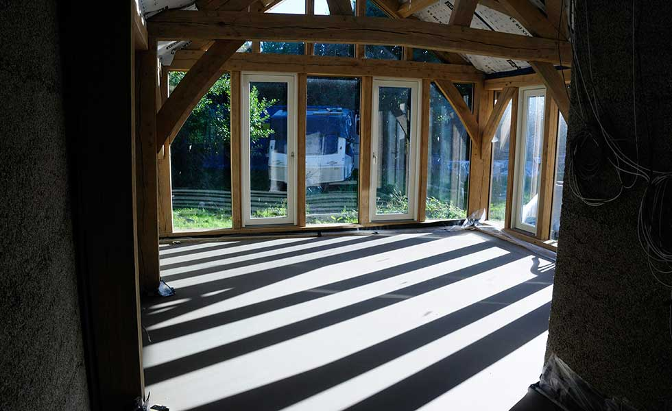 oak frame extension with glazing and screed floor