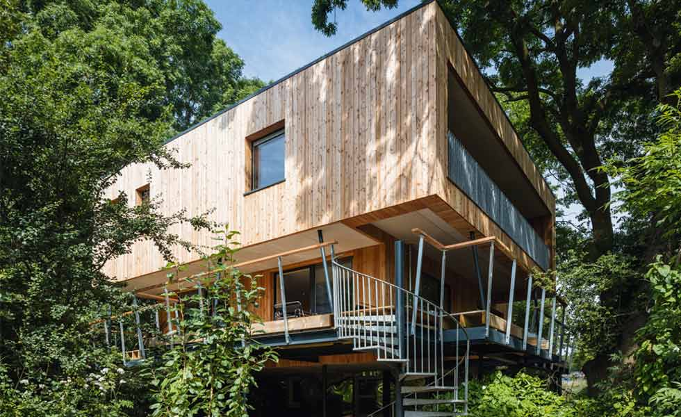 treehouse in woods passivhaus exterior