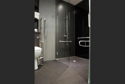 on the level Level access wet room design with vinyl flooring
