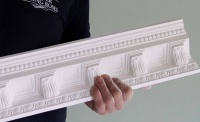 plaster coving in hand