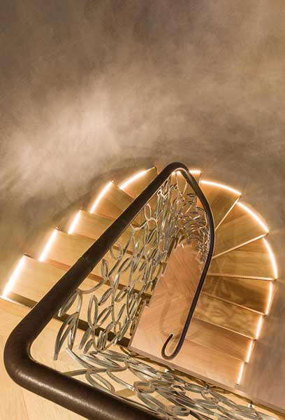 Illuminated treads on this Bisca staircase provide a warming glow