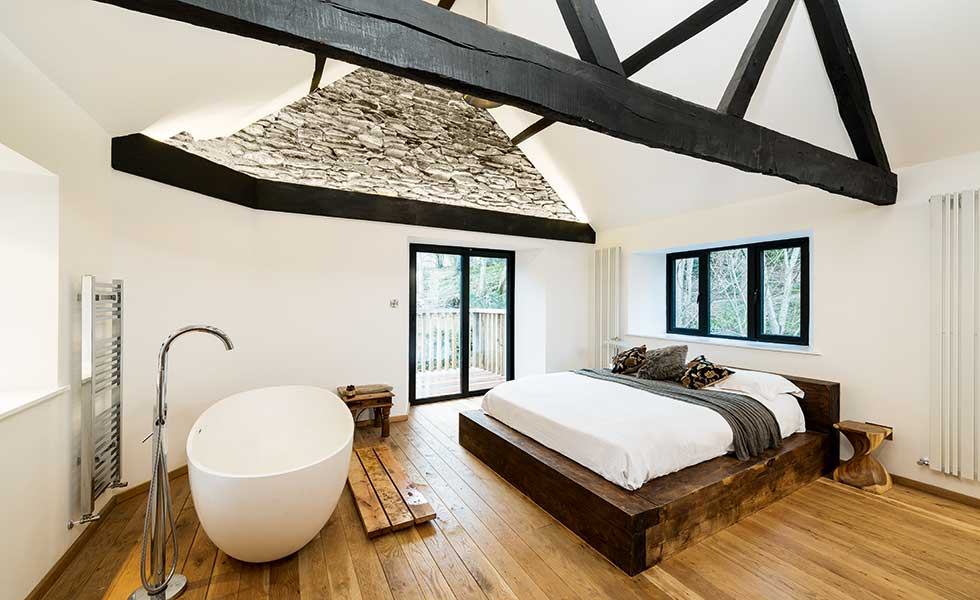 Strips of light illuminate the high ceilings in this converted mill
