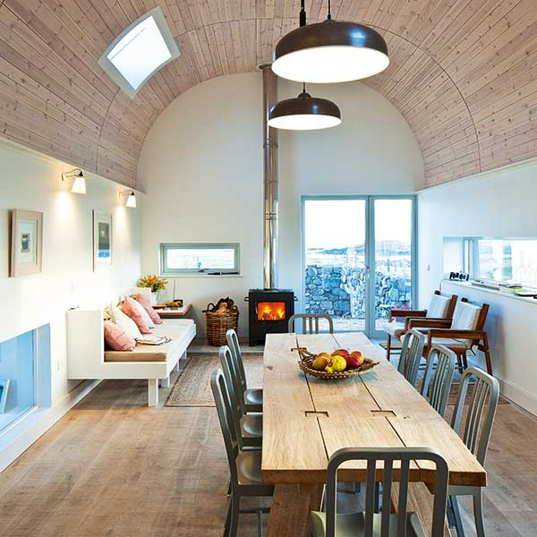 Dining-space-with-timber-clad-curving-ceiling