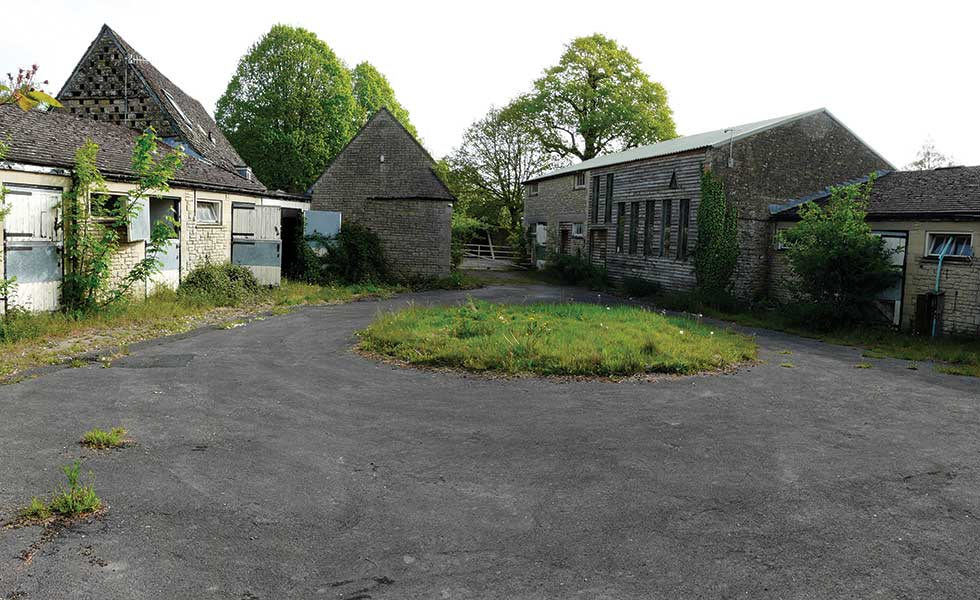 Unconverted barn with stables