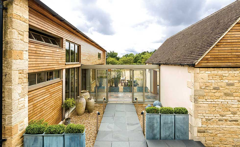 Stone and timber barn conversion with aluminium glazed link