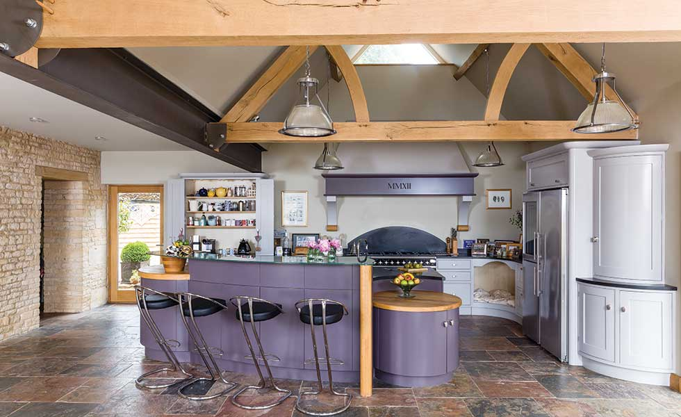 Barn conversion Shaker style kitchen with exposed timber beams