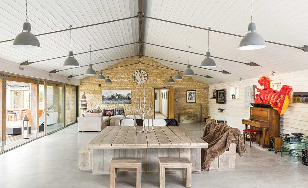 Barn conversion with poured concrete floor and exposed stone walls