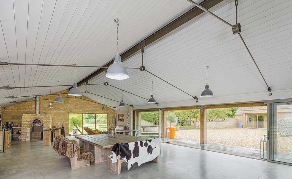 Barn conversion with poured concrete floor sliding doors and indoor pizza oven