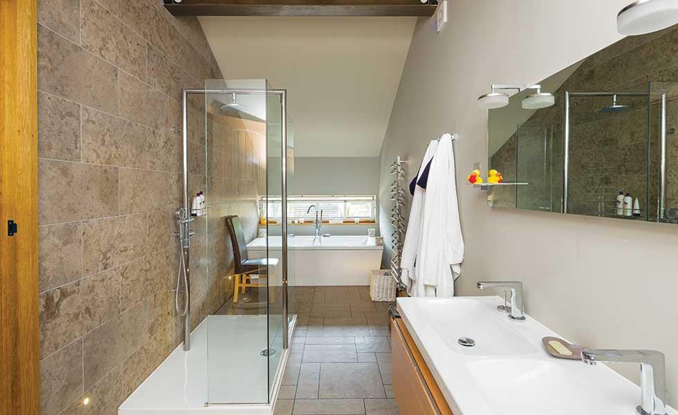 Barn conversion master bathroom with walk in shower