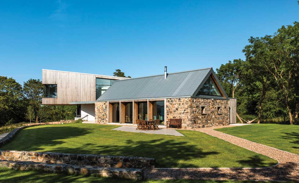 Stone barn conversion with cantilevered extension