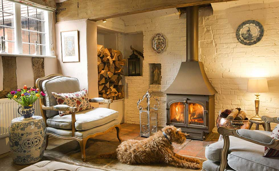 A relaxing lounge with a Clearview stove