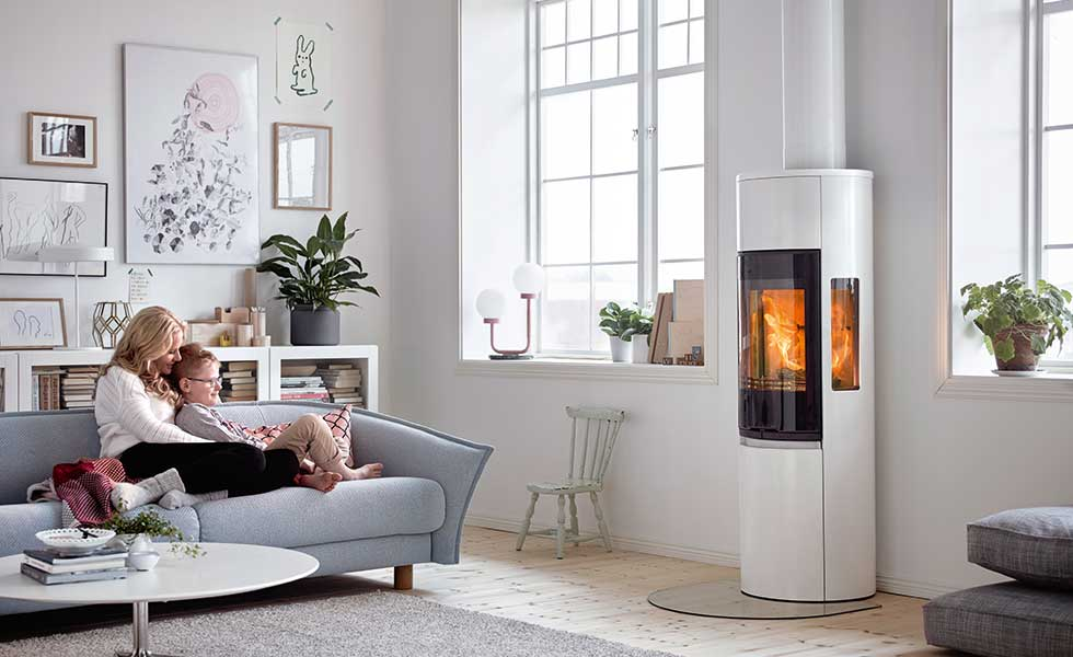 A cosy living room set up complete with a Contura woodburning stove