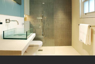 on the level Contemporary bathroom renovation with walk-in wet room