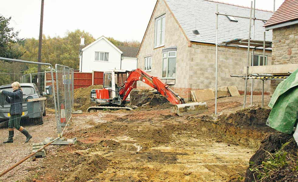 The foundations are dug outside David's house to make way for the gas tanks