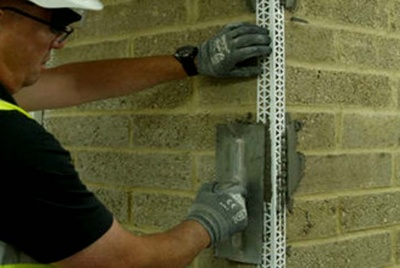 weberend bead adhesive being applied to corner wall