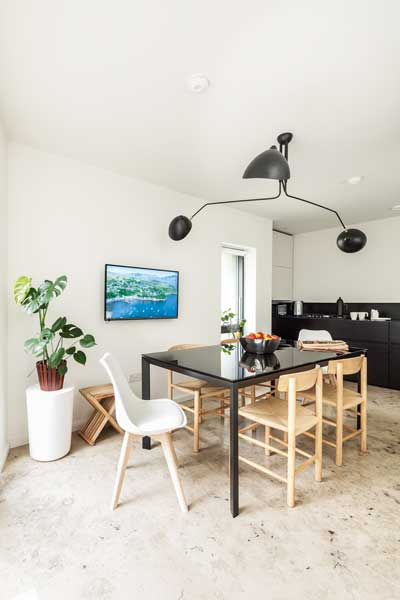 open plan kitchen diner with black dining table