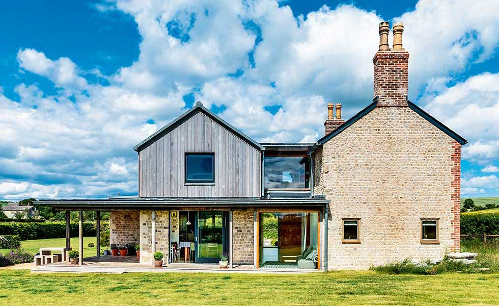cottage with timber-clad extension