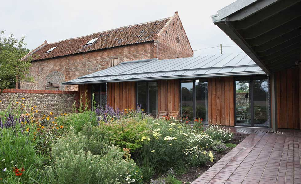 converted listed barns with clad extension