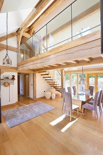 Open plan dining space with oak French doors