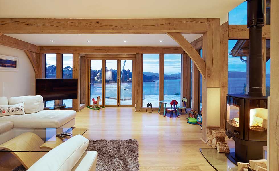 Living rooms with exposed oak beams and sea view