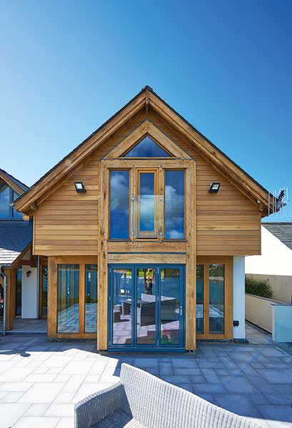Horizontal timber cladding with aluminium and oak windows and doors