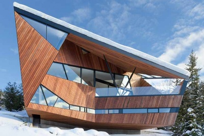 A dramatic ski chalet in Vancouver sits on the snowy mountain tops