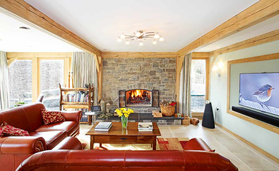 Exposed stone adds texture to this chalet style self build in Powys