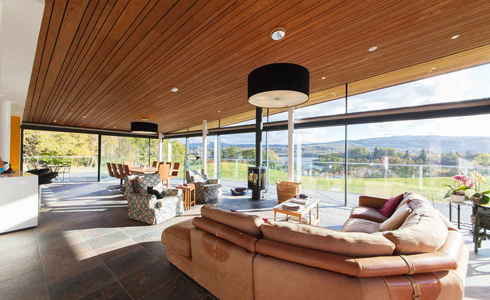 The ceiling of this living space designed by Alastair MacIntrye is clad in timber