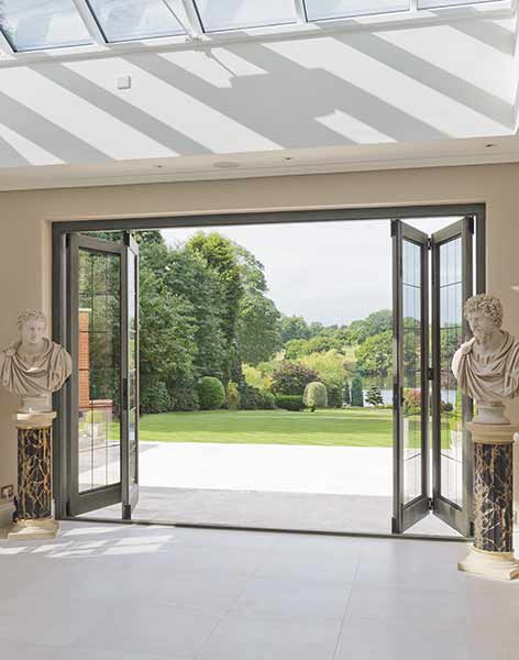 Bifold doors from Architectural Bronze Casements with a level threshold encourage indoor/outdoor living