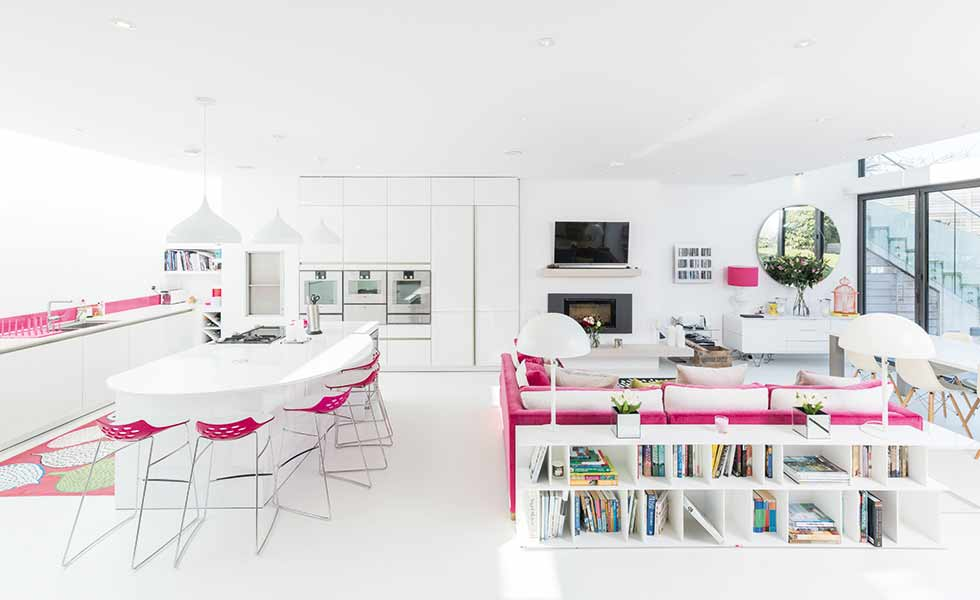 Clever furniture placement and lighting help to zone the spaces in this open plan living space
