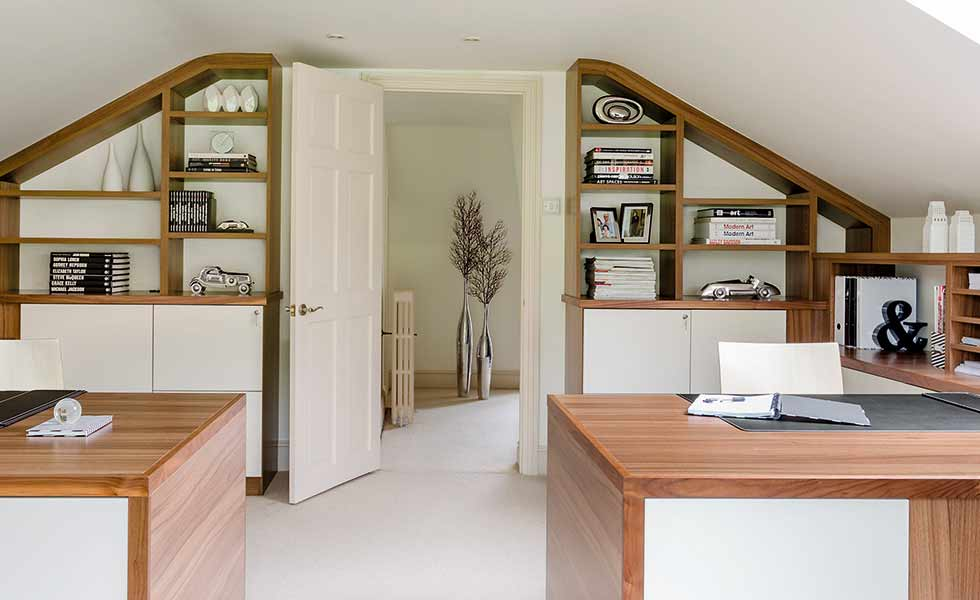This loft conversion features a home office set up with built in shelving from Neville Johnson, complete with two desk areas