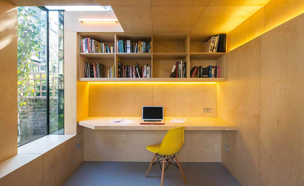 Layered LED lighting illuminates this garden home office