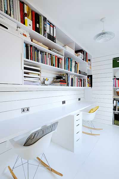 White timber cladding on the walls lend a Scandinavian style to this home office