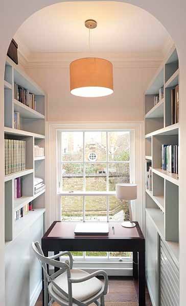 An alcove in this project allows for a quiet home office space lined with bookcases