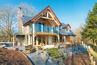Home with balconies above a river valley by Welsh Oak Frame