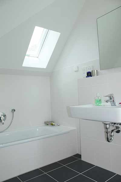 Rooflights in the bathroom spaces bring natural light into the home