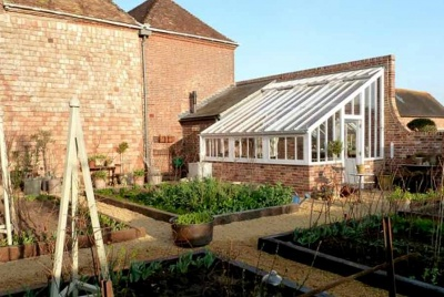 white cottage victorian greenhouse vegetable garden