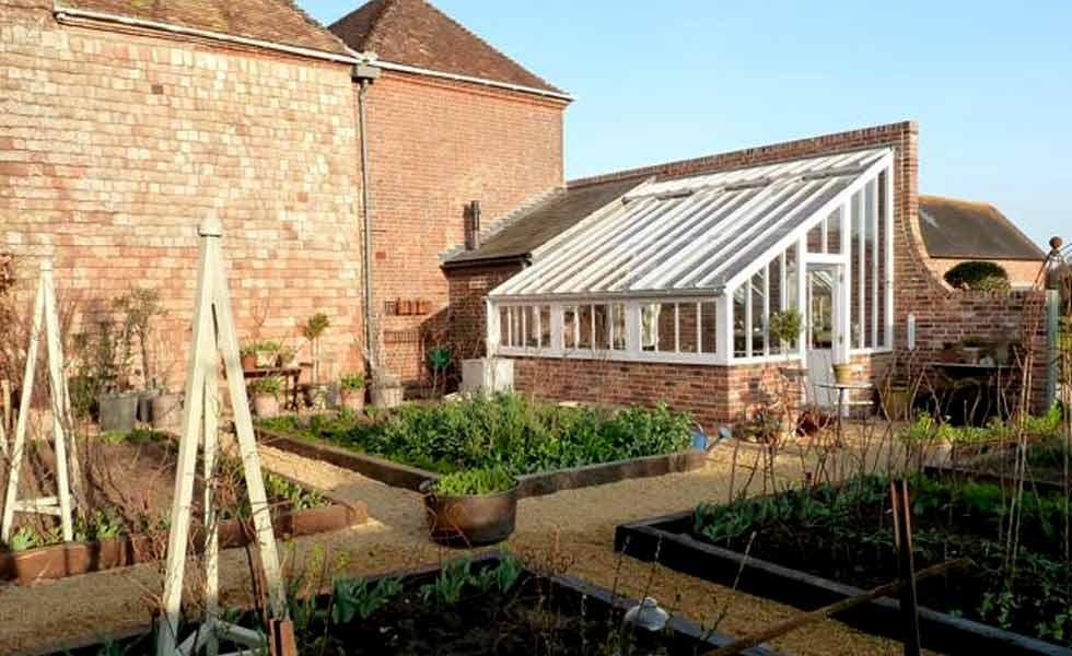 white cottage victorian greenhouse vegetable garden