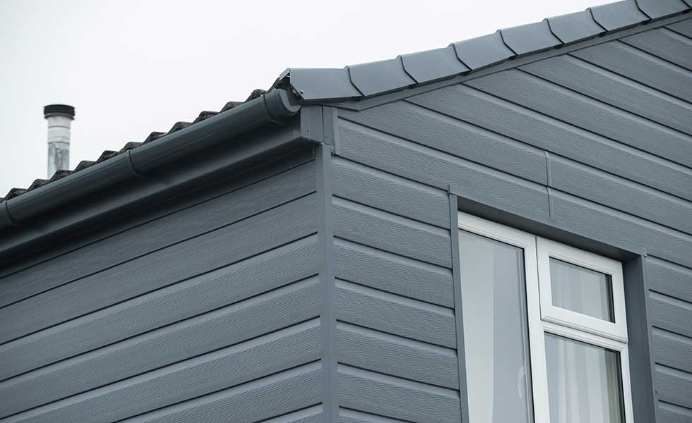 Grey PVC cladding on a home