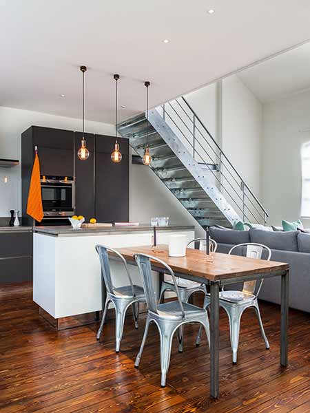 An industrial style has been adopted with stainless steel stairs