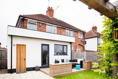 Contemporary rear extension with render and flat roof