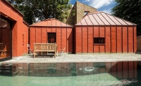 orange metal pavilion style home with courtyard and pool