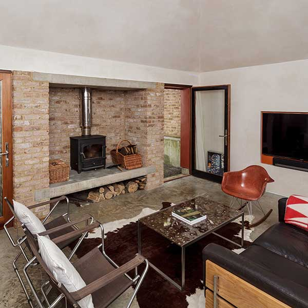 stone fireplace with log burner and living space
