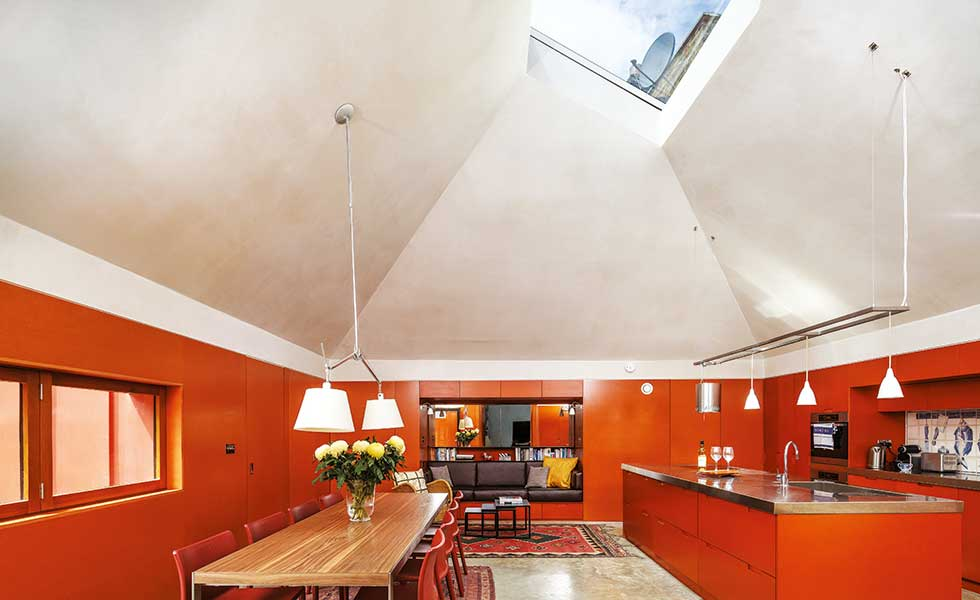orange kitchen diner with a pyramid vaulted ceiling