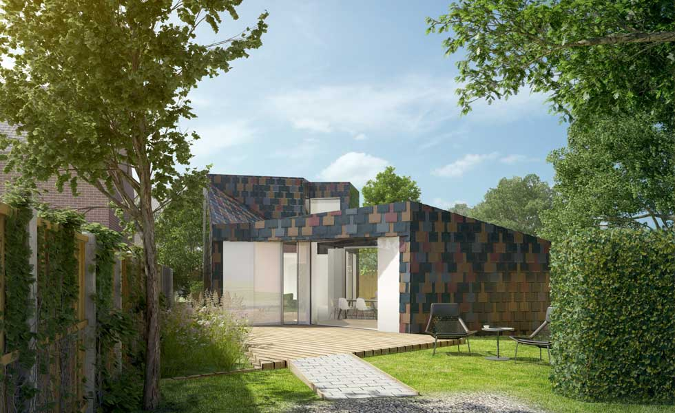 New build 2 bedroom retirement property clad in multi-coloured artificial slate.