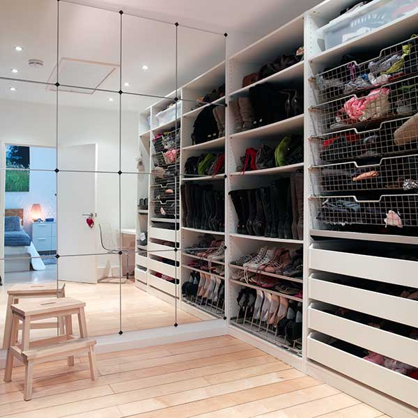 A walk-in wardrobe in this master suite offers an ideal storage solution